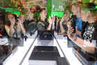 Attendees look at the Microsoft Xbox 360 at the 2013 E3 Electronic Entertainment Expo. Microsoft says it will stop making the console - the Xbox One replacement was launched in 2013. Photo / Getty