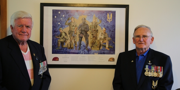 LEGACY: Former soldiers Sam McDonald and Rod Berge with a poster depicting SAS roles over the decades.PHOTO/NATALIE SIXTUS