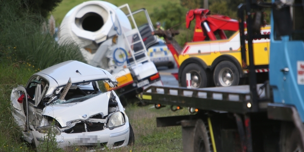 The damage done to a car after a collision with a concrete truck. Photo / Michael Cunningham