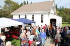 150 REASONS TO CELEBRATE: Past and present parishioners of St John's Church Matarawa catch up after yesterday's service.PHOTO/STUART MUNRO