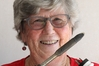 """Diane Storey, the first radio """"sparky"""" in the country, with the soldering iron she was using half a century ago. Photo / Duncan Brown"""