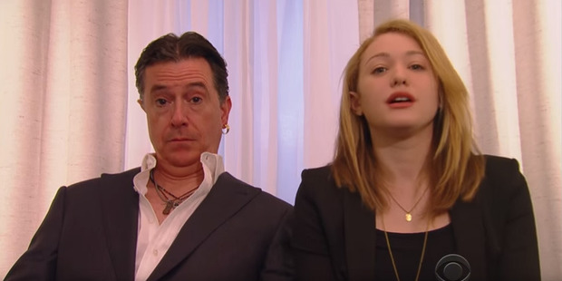 Loading In Colbert's version, he is dressed as Depp sitting next to a woman who resembles Heard.