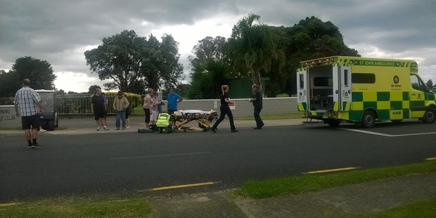 Loading A woman is treated by paramedics after being hit by a car on Matapihi Rd. Photo/Ruth Keber