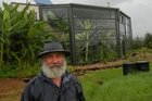 Carl Mather outside his home with its greenhouse extension. Photo / Mike Barrington
