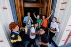 Whangarei Youth Music members Alex Winterton (left), Campbell Jones, Felicity Christian, Lee Jones, Frances Cristian-Farrow and Atawhai (centre left) and Purotu Martin as they move into the Old Library. Photo / John Stone
