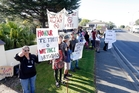 Placard and loud hailer-wielding protesters gathered outside yesterday's TPP roadshow in Whangarei. Photo / John Stone