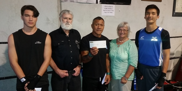 WORTHY WINNERS: Scholarship winners Kyle Chen (left) and Floyd Chadwick (right), with family friend Warrick Bleakley, Kaeo boxing coach Rusty Porter and Robin's mother Ninni Smyth.