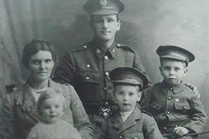 Bertha and William Harold, of Waimiro, with their three boys, Hugh (on his mother's lap), Ernie and Clarrie the middle son, sitting beside his father before he left for battle in August 1916.