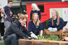 Prince Harry joins with University of Canterbury Student Volunteer Army students in 2015.