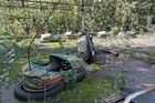 Abandoned bumper cars at Pripyat's amusement park. Photo / iStock