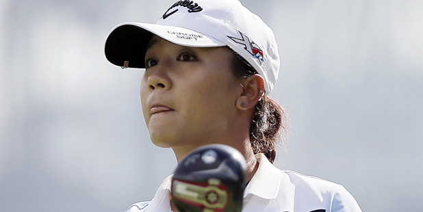 Loading Lydia Ko watches a tee shot. Photo / Getty