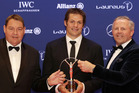 Steve Hansen, Richie McCaw and Sean Fitzpatrick hold the Laureus Team of the Year award. photo / AP