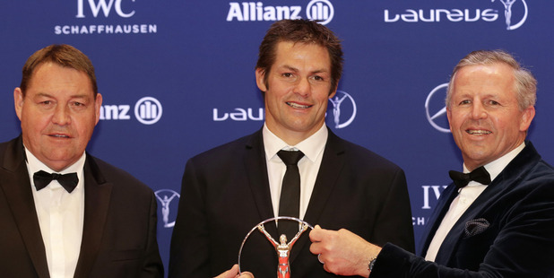 Loading Steve Hansen, Richie McCaw and Sean Fitzpatrick hold the Laureus Team of the Year award. photo / AP