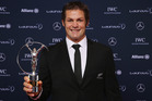 Former All Blacks captain Richie McCaw poses with the Laureus World Team of the Year trophy. Photo / AP