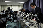 Top officials of Mitsubishi Motors bow at the end at the end of a news conference in Tokyo after admitting to manipulating fuel economy test data. Photo / Bloomberg