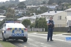 A Police dog shot and killed in Porirua and a police officer injured after jumping from second story of a house. A manhunt under way for Pita Rangi Tekira, as part of the Cannons Creek suburb is in lockdown.