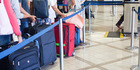 Before picking a queue, you need to make some Sherlock-style deductions about your fellow passengers. Photo / iStock