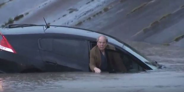 """What do I do?"" the man asked after his car became submerged. Photo / YouTube"