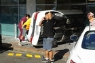 An elderly driver of a car has smashed through the front window of a medical lab in a Torbay shopping area.