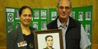 PROUD DESCENDANTS: Major William Porter's granddaughter, Melissa Peehikuru, and son Jim Porter, both of Auckland, with a portrait of their heroic forebear. PICTURE/PETER DE GRAAF