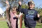 Brooklyn Sharplin, 5 (left) and Dexter Sharplin, 7, from Napier with their hard-won rainbow trout. Photo / Paul Taylor