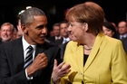 Obama and Merkel chat at the opening of the Hanover industry fair. Photo / AP