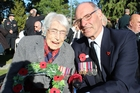 World War II nurse Beatrice (Betty) Wakely, 98, and her son Dennis wearing his father's World War II medals, at yesterday's Anzac Day civic service at the Cenotaph. Mrs Wakely is the last surviving female member of the Dannevirke and Districts RSA in Dannevirke who served overseas during World War II. Photo / Christine McKay