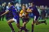 Te Puke Sports' halfback Luke Campbell makes a break against Te Puna under the lights last Friday night.