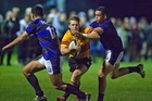 Te Puke Sports' halfback Luke Campbell makes a break against Te Puna under the lights last Friday night.