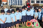 Students from Room 2 at Dannevirke South School with the wreaths on their Field of Remembrance following their Anzac service. Photo / Christine McKay