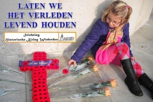 Residents and school children in the Dutch town of Wierden laid poppies on  the graves of airmen shot down over Holland. Pictured, Kees Kroon's 6-year-old granddaughter.