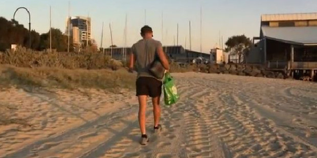 It's hard to storm off in sand while wearing shorty-shorts and holding an eco bag and a picnic blanket, but Jono does.