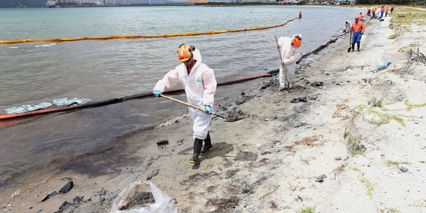 An exercise to clean up a simulated oil spill in Whangarei Harbour - which had about 7000 litres of oil leak from a ship last December (above) - is being held on Wednesday.
