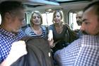 Australian TV journalist Tara Brown (second left) and Sally Faulkner (centre) sit in a mini van between the three crew members of Channel 9. AP photo / Hussein Malla