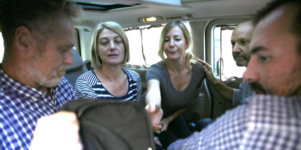 Australian TV journalist Tara Brown (second left) and Sally Faulkner (centre) sit in a mini van between the three crew members of Channel 9. AP photo / Hussein Malla