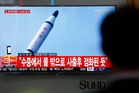 A man watches a TV news programme showing a file footage of a missile launch conducted by North Korea, at the Seoul Train Station in Seoul, South Korea. Photo / AP