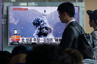 A TV news programme shows an image published in North Korea's Rodong Sinmun newspaper of a ballistic missile that the North claimed to have launched from a submarine. Photo / AP