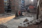 A Nepalese woman offers prayer at the compound that was destroyed during last year earthquake in Kathmandu, Nepal, Monday, April 25, 2016. Nepal'Prime Minister Khadga Prasad Oli has announced the star