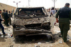 The scene after a suicide bomber detonated his explosives-packed vehicle at a military checkpoint in Damascus. Photo / AP