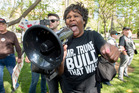 Republican presidential candidate Donald Trump supporter Chanell Temple yells at anti-Trump protesters during a rally in front of the Anaheim City Hall in Anaheim, California. Photo / AP