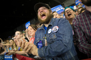Donnie Smith cheers as Democratic presidential candidate Bernie Sanders speaks in West Virginia. Photo / AP