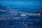 Solar Impulse 2 flies over San Francisco. Photo / AP