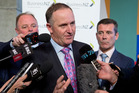 Prime Minister John Key, flanked by Small Business Minister Craig Foss, left, and Revenue Minister Michael Woodhouse. Photo / Mark Mitchell