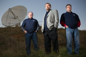 Professor Sergei Gulyaev (centre), director of AUT's Institute of Radio Astronomy and Space Research, stands with colleagues Tim Natusch (left) and Stuart Weston.
