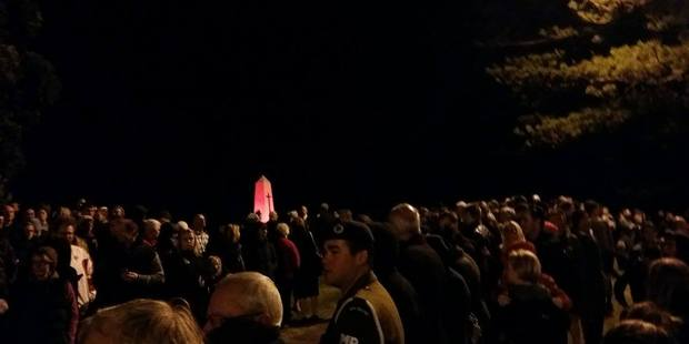 Large crowds have gathered in Mount Maunganui for this morning's Anzac Day dawn service. Photo/Anna Whyte