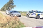 The body found in rural Canterbury was removed from the scene in a hearse at around 1.30pm - more than 26 hours after it was first found.