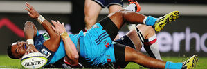 Lolagi Visinia of the Blues reaches out to score a try against the Rebels. Photo / Getty