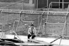 File photo a lone soccer supporter sits by the damaged fencing at Hillsborough Stadium. Photo / AP