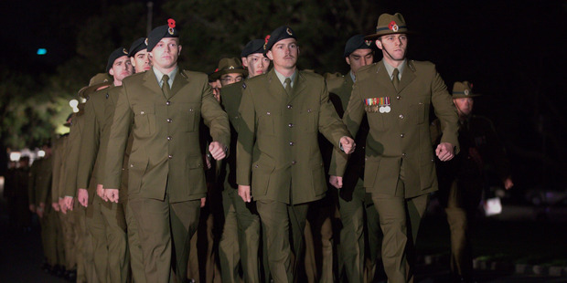Loading Members of the armed forces march at the Auckland domain for the first dawn service of the the morning for Anzac Day. Photo / Nick Reed