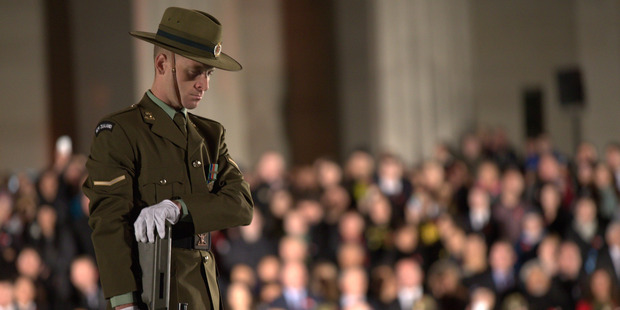 A guard stands on the cenotaph at the Auckland domain for the first dawn service of the morning. Photo / Nick Reed